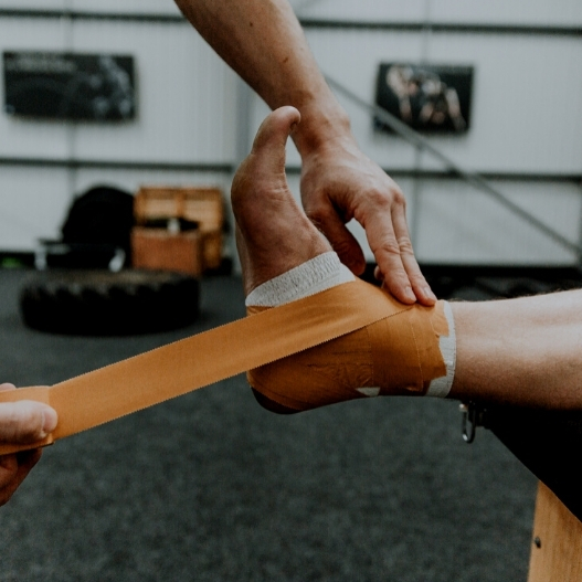 image showing how to strap a sprained ankle with tape